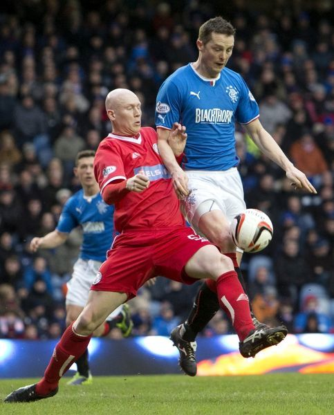 Rangers' Jon Daly and Brechin City's Gerry McLauchlan (L) fight for the ball