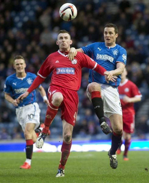 Rangers' Jon Daly and Brechin City's Graham Hay (L) in action