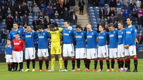 Rangers players pay their respects to the victims of the Hillsborough disater
