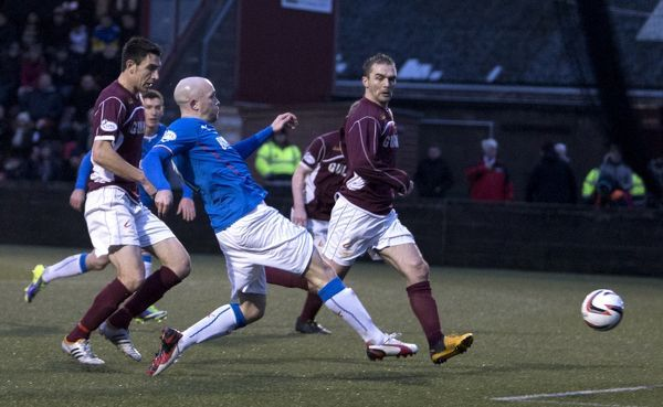 Rangers' Nicky Law scores the opening goal
