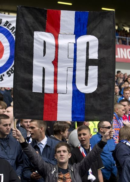Rangers fans in the stands with a banner