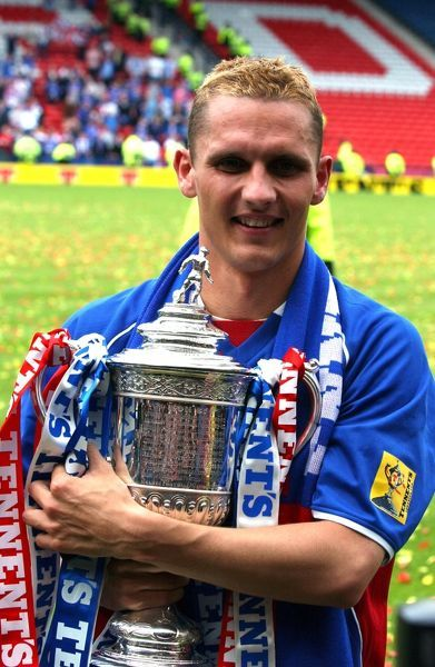Rangers' Peter Lovenkrands holds tightly the Tennants Scottish FA Cup
