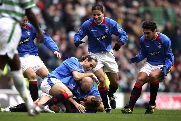 Rangers players congratulate Fernando Ricksen after equalising in the second half