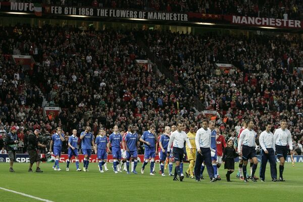 Manchester United and Rangers walk out onto the pitch