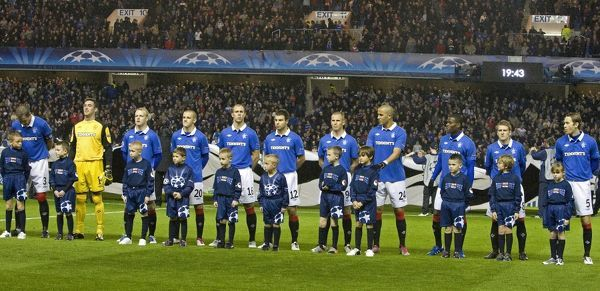Rangers' players line up at the start of the match with the mascots