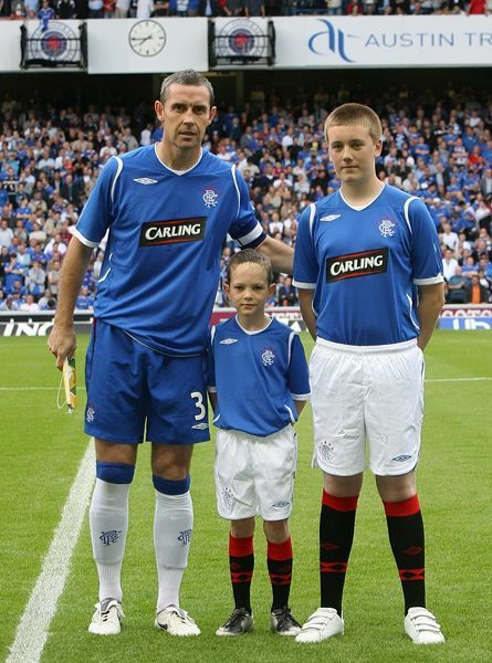 Rangers' captain David Weir poses with the mascots before the match