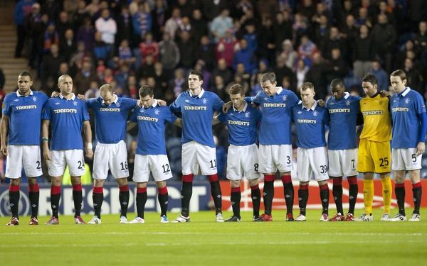 Rangers' players have a moments silence for the Japan earthquake and tsunami