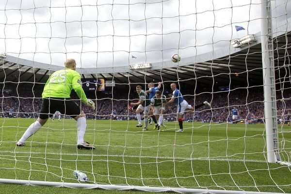 Rangers' Kenny Miller scores past Hibernian goal keeper Conrad Logan during the William Hill Scottish Cup Final at Hampden Park, Glasgow
