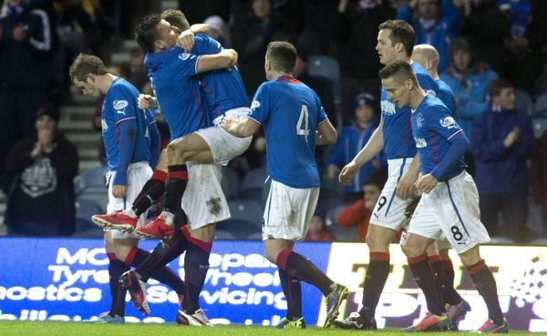 Rangers captain Lee McCulloch hus hat-trick hero Dean Shiels after he scored his third goal