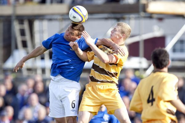Rangers' Lee McCulloch and Forres Mechanic's Graham Fraser