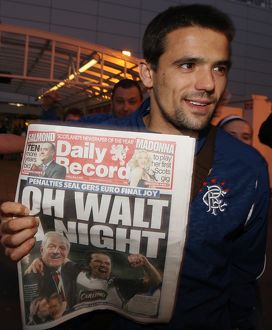 Soccer - Rangers return after winning place in UEFA Cup Final-